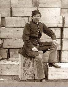 Soldier sitting on a box of hardtack
