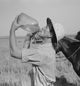 """Rice farmer drinking in the fields, Crowley, Louisiana"" by Russell Lee, 1938"
